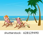Couple Sitting In Deck Chairs...