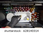 tattooist selects a color from... | Shutterstock . vector #628140314