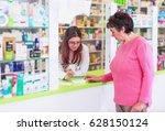 female pharmacist discusses...   Shutterstock . vector #628150124