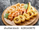 seafood platter with deep fried ... | Shutterstock . vector #628163870
