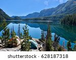 camping tents near lake in... | Shutterstock . vector #628187318