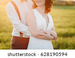 The Groom Hugs Bride From...