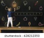 little girl writing on... | Shutterstock . vector #628212353