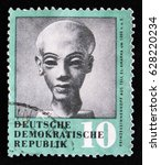 Small photo of MOSCOW, RUSSIA - APRIL 2, 2017: A post stamp printed in Germany shows doll head of Egyptian princess Amarna, circa 1979