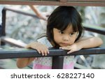asian child lonely in a park | Shutterstock . vector #628227140