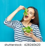 happy young woman eating salad... | Shutterstock . vector #628260620