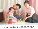 asian parent playing toys with... | Shutterstock . vector #628305080