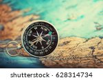 Compass On Map. Travel And...