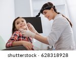 smiling ent doctor examining... | Shutterstock . vector #628318928