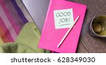 Small photo of Pink notebook, pen and note with the text Good Job / Good Job / Laud
