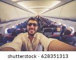 handsome man taking selfie with ... | Shutterstock . vector #628351313