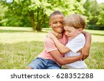 two kids scuffle in the park...   Shutterstock . vector #628352288