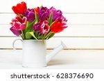 tulip bouquet on  wooden... | Shutterstock . vector #628376690