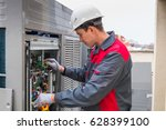 specialist cleans and repairs... | Shutterstock . vector #628399100