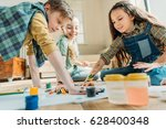 cute kids painting on paper... | Shutterstock . vector #628400348