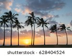 sunset palm beach with dramatic ... | Shutterstock . vector #628404524