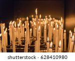 burning candles in a church | Shutterstock . vector #628410980
