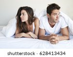 awkward couple lying in bed ... | Shutterstock . vector #628413434