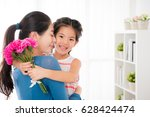 asian young mother embrace with ... | Shutterstock . vector #628424474