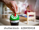 man putting used batteries into ...   Shutterstock . vector #628450418