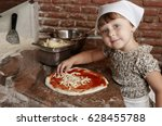 little girl preparing pizza on... | Shutterstock . vector #628455788