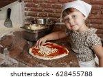 Little Girl Preparing Pizza On...
