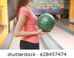 young woman with ball in... | Shutterstock . vector #628457474