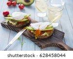 eggs for breakfast on toast... | Shutterstock . vector #628458044