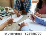 students doing homework together | Shutterstock . vector #628458770