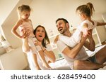 cheerful family playing... | Shutterstock . vector #628459400