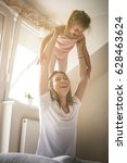 single mother plating with her... | Shutterstock . vector #628463624