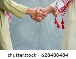 arab business man handshake in... | Shutterstock . vector #628480484