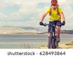 mountain biker riding on bike... | Shutterstock . vector #628493864