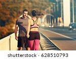 happy couple exercising... | Shutterstock . vector #628510793