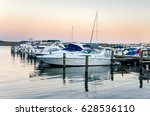 Boats Moored To A Jetty On The...