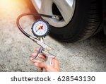 gun pressure gauge holding in... | Shutterstock . vector #628543130