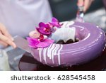 the chef covers the purple cake ... | Shutterstock . vector #628545458