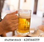 beer mug in a cafe .   Shutterstock . vector #628566059