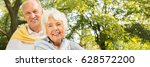 smiling elderly couple spending ... | Shutterstock . vector #628572200