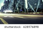 modern urban traffic at night | Shutterstock . vector #628576898