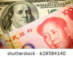 chinese yuan note and u.s.... | Shutterstock . vector #628584140