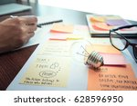 light bulb on table with... | Shutterstock . vector #628596950