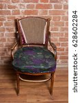 Small photo of Renovation of old furniture - an old wooden armchair. We polish the old varnish and paint with acrylic paint. We create craquelures. Vintage style