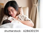 mother breastfeeding her... | Shutterstock . vector #628630154