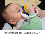 baby boy playing with toy | Shutterstock . vector #628634174