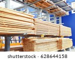 many wooden planks in hardware... | Shutterstock . vector #628644158