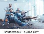 cheerful colleagues enjoying... | Shutterstock . vector #628651394