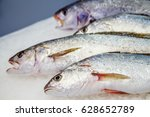 Small photo of fresh meagre on ice at seafood market