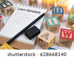 wood letter blocks alphabet abc ... | Shutterstock . vector #628668140
