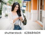 asia woman walking and using a...   Shutterstock . vector #628684604